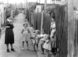 Mary Andrews visiting a family in Erskineville.